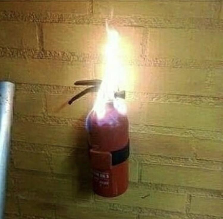 fire extinguisher on fire.jpg