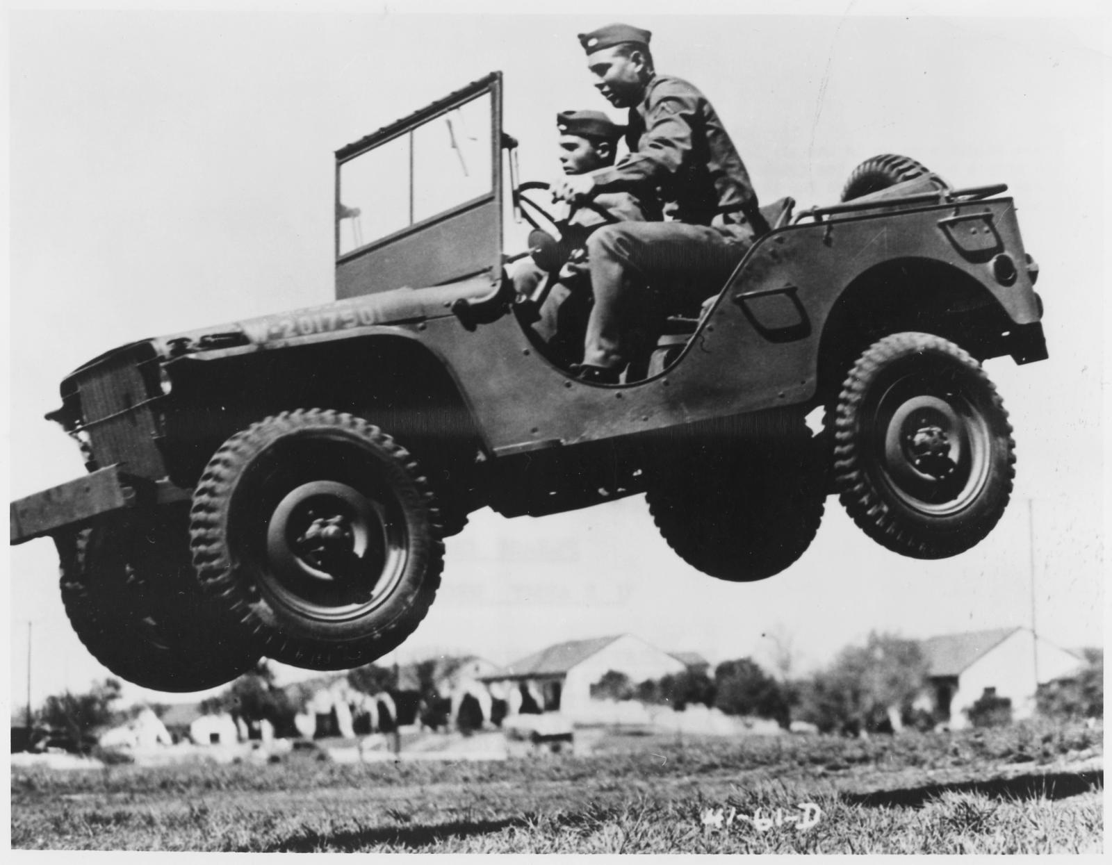 These_soldiers_go_up_in_the_air_to_prove_that_the_Army's_new_quarter_ton_truck_can_take_it._-_NARA_-_195336.jpg