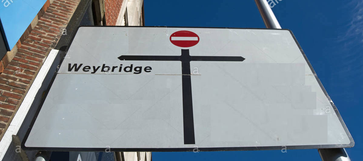 road-sign-in-walton-on-thames-surrey-england-giving-directions-to-J6CFRB.jpg